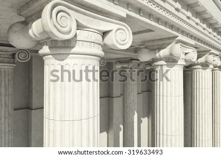 Close-up shot of a line of Greek-style columns. Royalty-Free Stock Photo #319633493