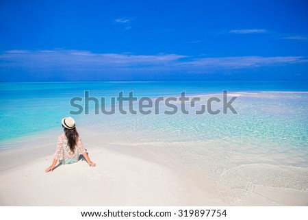 Young happy woman enjoy summer vacation on white sandy beach #319897754