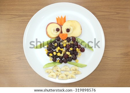 design food. Creative fruits for a child with a picture penguin