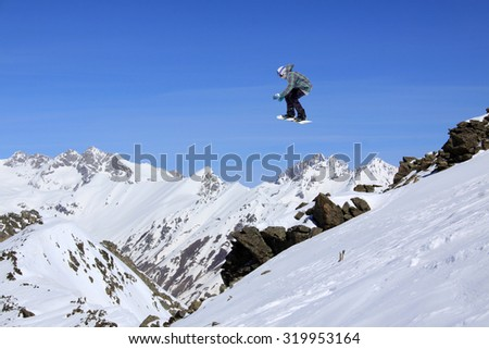 Flying snowboarder on mountains, extreme sport #319953164