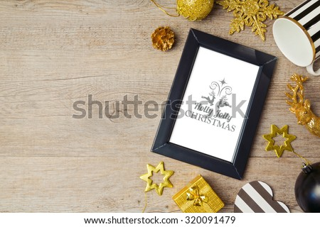 Christmas background with poster mock up template and decorations. View from above