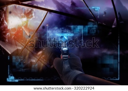 Hand in gloves holding a pointing straight handgun. First person view hand in black leather gloves holding a futuristic fantasy neon pointing straight handgun with neon red, blue indicator panels.