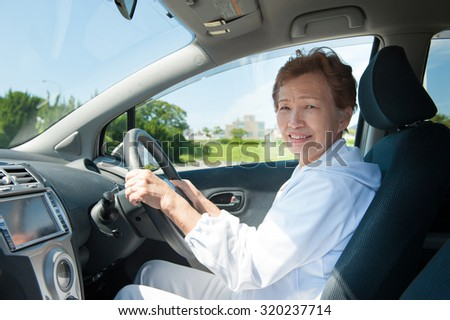 Elderly women who are driving a car #320237714