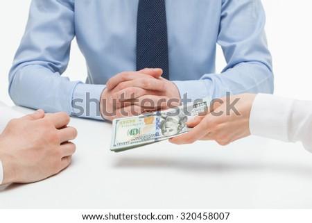 Female hand shoving money under business partner's hand, white background #320458007