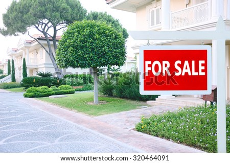 Real estate sign in front of new house for sale #320464091
