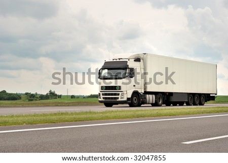 one of white truck on highway (moving from right to left) #32047855