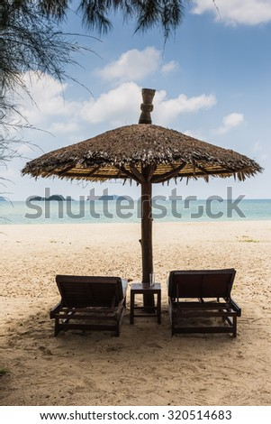 beach umbrellas and deck chairs on the shores of paradise #320514683