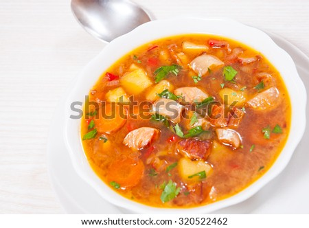 Fish soup with vegetables #320522462
