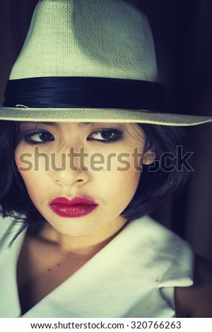 head shot of asia woman with hat in room, beauty concept, vintage style #320766263