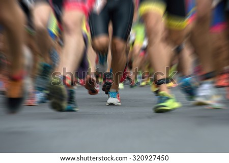 Marathon runners in the race,abstract #320927450