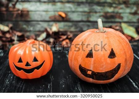 Happy Halloween. Holiday pumpkins and decorations. Pumpkin on autumn street. Preparations for the holiday decoration bats and manufacturing Hallowe'en pumpkin #320950025