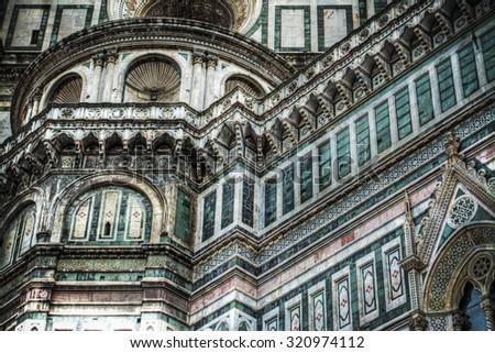 detail of Santa Maria del Fiore facade in Florence, Italy #320974112