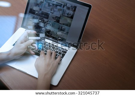 top view of hands using laptop and holding credit card with social media diagram as Online shopping concept #321045737
