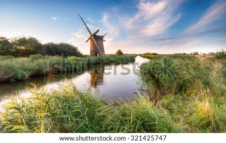 The beautiful ruins of the Brograve Windmill near Horsey on the Norfolk Broads Royalty-Free Stock Photo #321425747