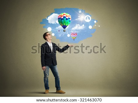Young man presenting in hand media balloon icons on color background #321463070