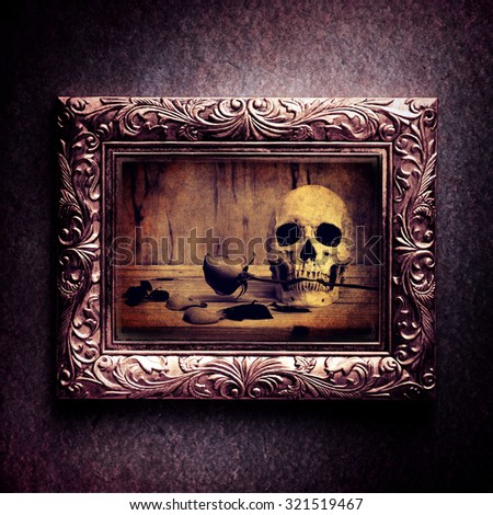 Vintage photo frame, photo of skull with rose over grunge background, Halloween concept,