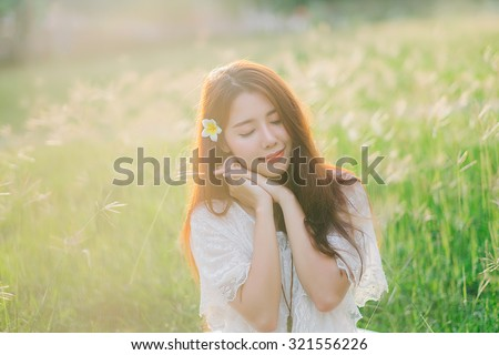 Dreaming concept. Outdoor portrait of a beautiful teenage asian girl vintage and retro tone, soft focus.