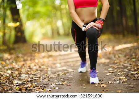 woman exercising and stretching muscles before sport activity in park #321591800