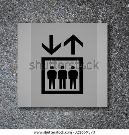 Lift or elevator symbol on concrete wall background