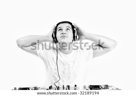 young dj man with headphones and compact disc dj equipment #32189194