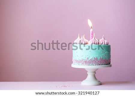 Birthday cake with one candle Royalty-Free Stock Photo #321940127