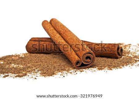 Cinnamon sticks and powder on white background #321976949