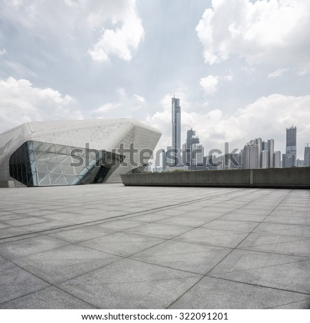 empty, modern square and skyscrapers in modern city Royalty-Free Stock Photo #322091201