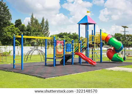Colorful playground on yard in the park. Royalty-Free Stock Photo #322148570