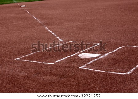 A close-up of the batters boxes and home plate on a vacant baseball diamond. #32221252