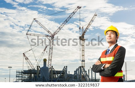 Businessmen engineering standing handsome smile in front of builders at construction site looking away #322319837