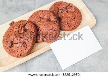Homemade chocolate cookies with blank name card, stock photo
