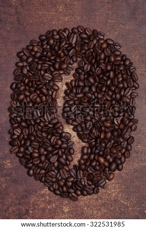 Shape of a coffee bean made from brown roasted coffee beans #322531985