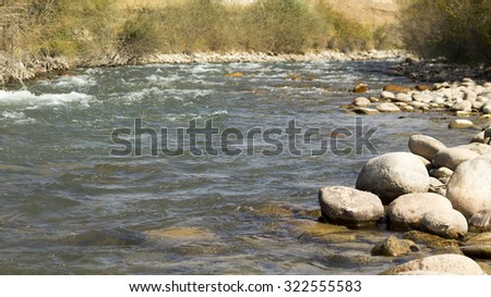 Mountain river with stones  #322555583