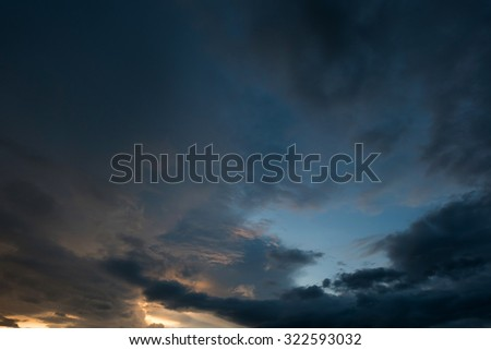 twilight sunset sky with cloudy and sunlight through clouds #322593032
