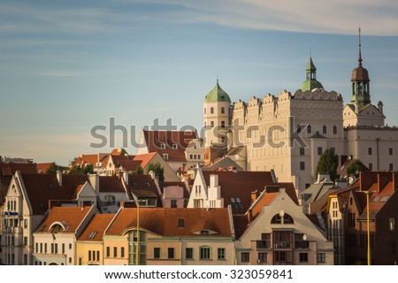 White castle with towers and green roofs and red roofs of residential and office houses in Szczecin, Poland Royalty-Free Stock Photo #323059841