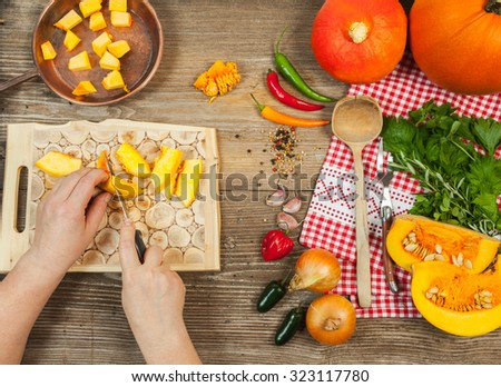 Cooking pumpkin Background, top view, hands - mooving blur. Vegetarian food, health or cooking concept.  #323117780