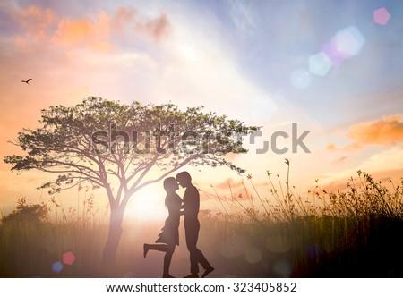 Silhouette Adam and Eve on Eden garden background. #323405852