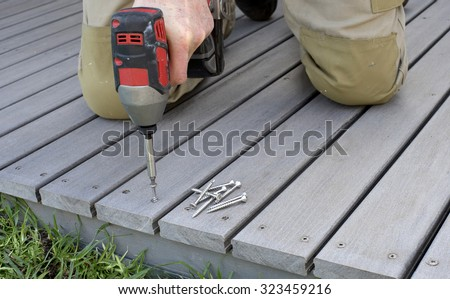 fixing composite decking with a screw gun #323459216