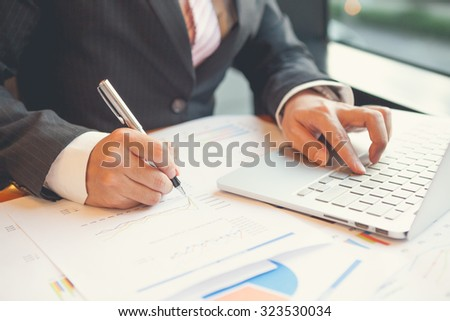 Young businessmen using Notebook and writing business plan at meeting in office #323530034