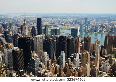 Manhattan midtown view with big skyscrapers, New York City, USA. Manhattan beautiful skyline panorama, NYC. Top of the buildings in financial district. Business background. #323694602