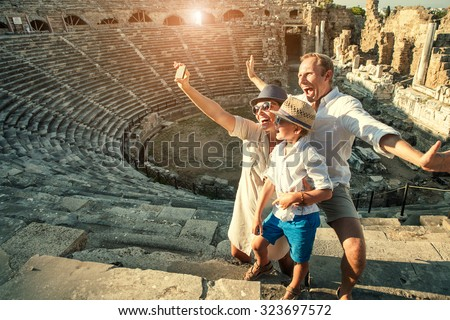 Funny family take a self photo in amphitheater building.Side,Turkey