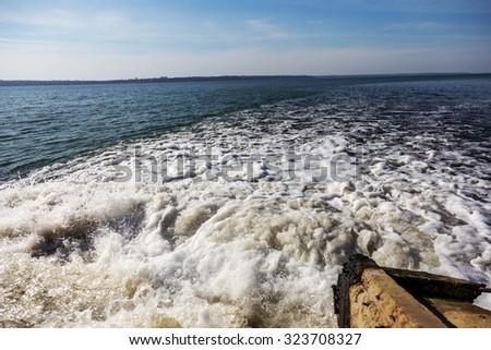 Dirty waste water from the municipal sewer openly merge into the marine estuary. Wastewater treatment plants. The environmental problem of environmental pollution. #323708327