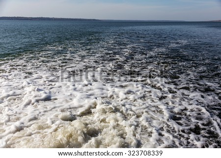 Dirty waste water from the municipal sewer openly merge into the marine estuary. Wastewater treatment plants. The environmental problem of environmental pollution. #323708339