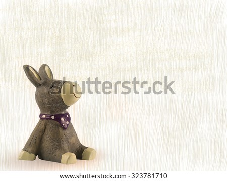 statue toy of donkey. Idea for decoration, happy, smiling, birthday card, invitation card, hope, wish, wishing, thinking background concept wallpaper