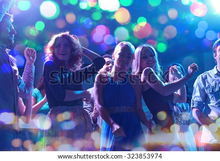 party, holidays, celebration, nightlife and people concept - group of happy friends dancing in night club #323853974