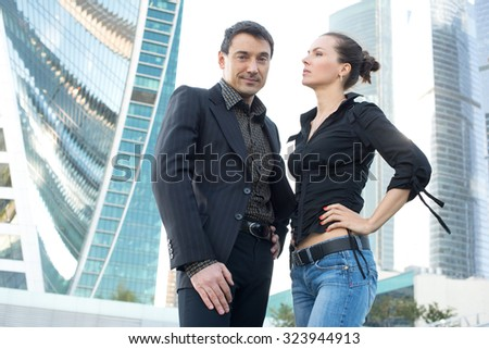 office workers outdoor. Businessman and businesswoman in the city #323944913