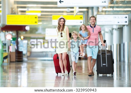 Happy family with children at the airport #323950943