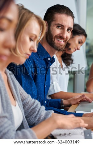 portrait of professional business man during boardroom meeting with coworkers #324003149