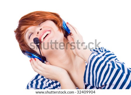 Beautiful blue-eyed girl with headphones on laughing #32409904