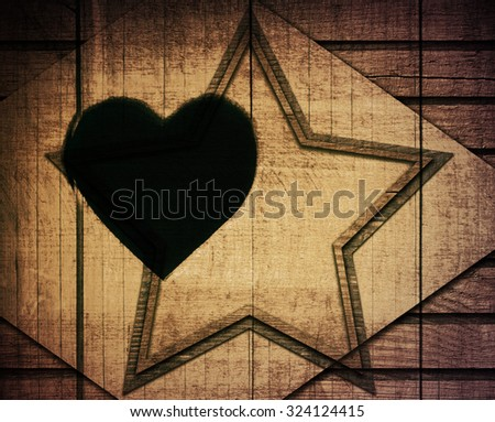 Double exposure of brown wooden star with rhombus and frame on planks wall #324124415